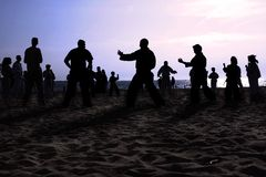 Tai Chi Beach II. Tai Chi exercise at the beach royalty free stock images