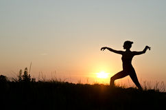 Tai chi chuan. Woman praticing tai chi chuan at sunset stock image