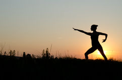 Tai chi chuan. Woman praticing tai chi chuan at sunset Stock Photography