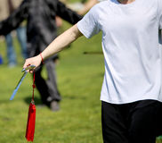Tai Chi martial arts athlete expert makes motions with sword Royalty Free Stock Images