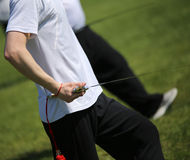 Tai Chi martial arts athlete expert makes motions with sword. Tai Chi martial arts young athlete expert makes motions with sharp sword Stock Photo
