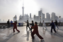 Tai chi. People at the bund, Shanghai,China stock images