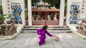 Tai Chi practice. Woman practice Tai Chi in front of the old shrine royalty free stock images