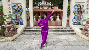 Tai Chi practice. Woman practice Tai Chi in front of the old shrine Stock Image
