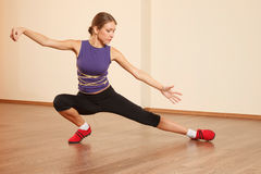 Tai Chi practicing. Young woman at gym is practicing Tai Chi royalty free stock photo