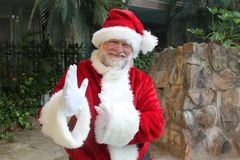Tai Chi Santa. Santa doing a tai chi move in a tropical setting stock photos