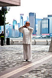 Tai Chi teacher instructs Tai Chie in public Stock Image