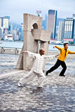 Tai Chi teacher instructs Tai Chie in public. HONG KONG - JANUARY 8: Tai Chi Public Exercising in early morning at January 08, 2010 in Hongkong.  The old teacher Royalty Free Stock Image