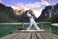 Tai chi. Young woman making tai chi exercise at a lake royalty free stock photos