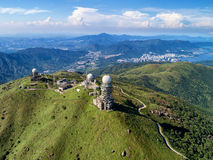 Tai Mo Shan. Is the highest peak in Hong Kong, with an elevation of 957 m. It is also the tallest coastal peak in Southern China and second tallest coastal peak royalty free stock photography