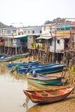 Tai O Fishing Village, Lantau Island, Hong Kong, China. Traditional homes on stilts with fishing boats tied up at the Tai O Fishing Village, Lantau Island, Hong royalty free stock images