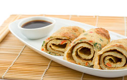 Tai omelet. With soy sauce, shot on white, shallow DOF Royalty Free Stock Image