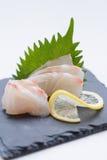 Tai Sashimi : Sliced Raw Tai Red Seabeam Fish Served with Sliced Radish on Stone Plate.  Stock Photo