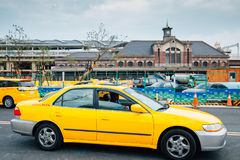 Old Taichung railway station and yellow taxi in Taiwan