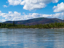 Taiga hills at Steward River near town of Mayo Royalty Free Stock Photo