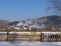Taiga village in the winter morning Royalty Free Stock Photo