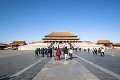 Taihe hall and the square in Forbidden City. Beijing, China - December 25, 2014: Tourists visit Forbidden City Royalty Free Stock Photo