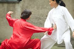 Taiji Pushing Hands. Is important in Taiji practice, performed by two elder people in Chongqing,China stock images