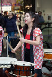 Taiko drummers girls. Moscow, Russia - March 5, 2017: group of Japanese Taiko drummers girls perform in `Oceania` shopping center on the at the opening of a new Royalty Free Stock Photo
