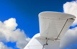Tail of a aircraft with a blue sky and clouds Royalty Free Stock Photo