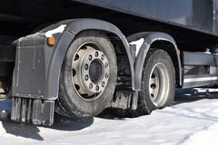 Back wheels of truck in winter stock photography