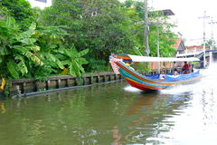 Tail boat on canal Royalty Free Stock Image