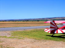 Tail of colorful biplane. Colorful tail of biplane by runway on Aldinga airfield with blue sky background and copy space, Southern Australia royalty free stock photography