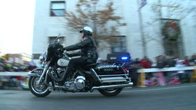Tail end of police motorcade at parade stock video