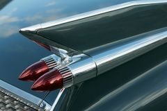 Tail Fin of American Car. A closeup of beautiful chrome tail fin of vintage elegant American classic car. Shallow selective focus Stock Images