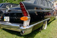 Tail fin and rear lights of GAZ-13 Chayka vintage car - Stock image Royalty Free Stock Photos