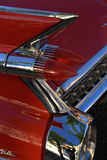 Tail fin of a red vintage car. The tail fin of a red vintage car with chrome Royalty Free Stock Images