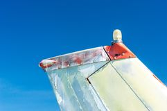 Tail fin, rudder and beacon lights, small single engine airplane with old paint and bright blue sky. Tail fin, rudder and beacon lights, small single engine royalty free stock photo