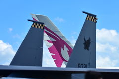 Tail fins of RSAF F-15SG and Qatar Airways A380 at Singapore Airshow Stock Images