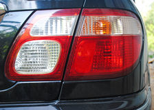 A tail light of Black car. A tail light of car Royalty Free Stock Images