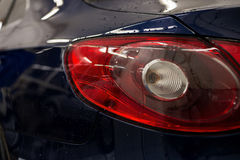 Tail light car with water drops. Exterior auto detail Stock Image