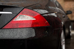 Tail light car with water drops. Stock Photography