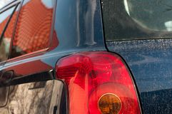 Tail light on modern dirty japanese car royalty free stock photography