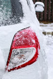 Tail light rear light under the snow. Winter time Royalty Free Stock Photos