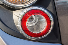Tail light. The tail light is a warning signal for cars that are behind. Knowing to stop or turn left or turn right Royalty Free Stock Photo