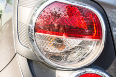 Tail light. The tail light is a warning signal for cars that are behind. Knowing to stop or turn left or turn right Stock Photos