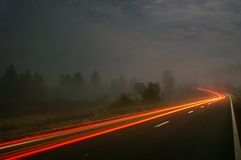 Tail lights. From a car passing by in the dawn mist Stock Photography