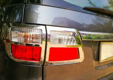Tail lights of car. S SUV on the left. A modern and very beautiful royalty free stock image