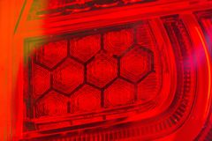 The tail lights of some modern innovative cars that change from ordinary tube to LED.  stock photography