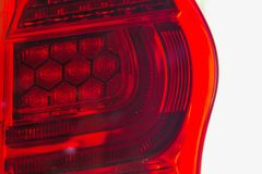 The tail lights of some modern innovative cars that change from ordinary tube to LED.  royalty free stock images
