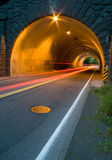 Tail Lights Through Tunnel. The tail lights from a car pass through a tunnel on Burnside in Portland, OR royalty free stock images