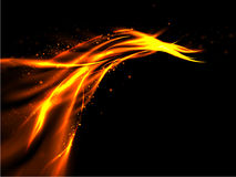 The tail of orange gold abstract fiery flashes with stars on black background Royalty Free Stock Image