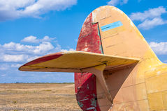 The tail part of the old plane. The blue sky background Royalty Free Stock Images