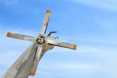 Tail rotor grey helicopter of Thai army on blue sky. Background Royalty Free Stock Image