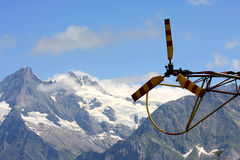 Tail and rotor of a helicopter in the Swiss mounts stock photos