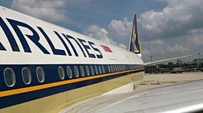 Tail of Singapore airlines plane Stock Photos